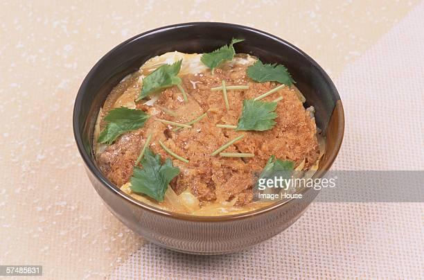 Pork cutlet stew in bowl (Katsu don), close-up