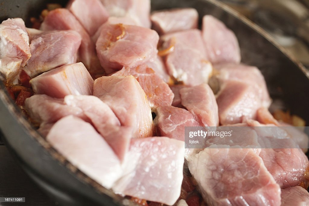 Pork in frying pan : Stock Photo