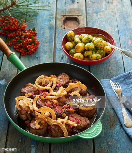 Pork medallions with apple and plum compote