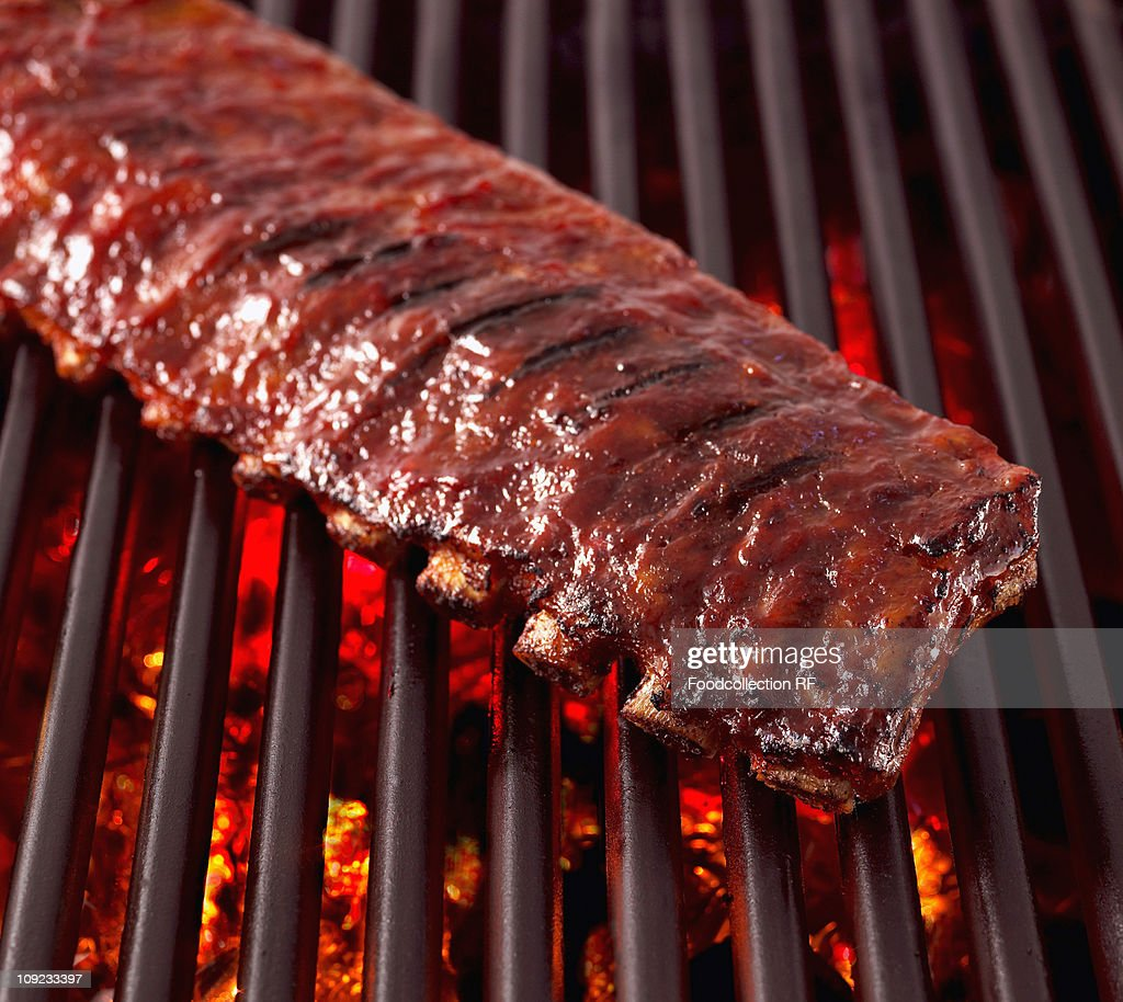 Pork ribs on grill, close-up