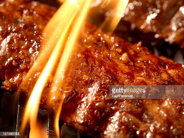 Pork ribs on the BBQ grill with bright flame