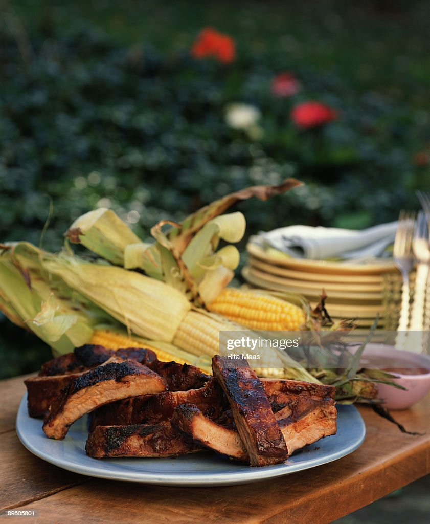 BBQ pork ribs with grilled corn : Stock Photo