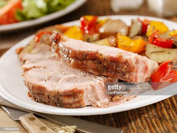 Cerdo asado a la cena
