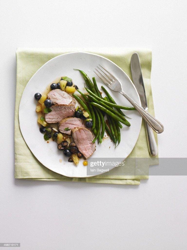 pork tenderloin and green beans : Stock Photo