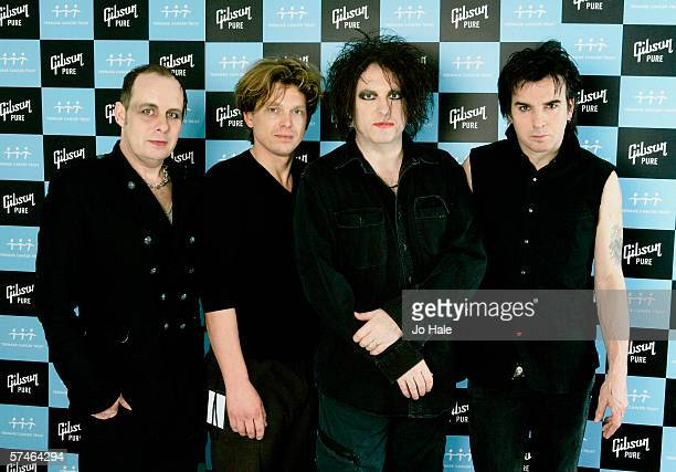Porl Thompson Jason Cooper Robert Smith and Simon Gallup of The Cure pose backstage on the sixth and final night of a series of concerts and events...