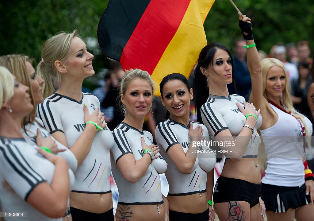 Porn actresses with body paint football jerseys in the colors of Germany poses as they take part in a fun soccer match of Germany vs Denmark on June 16, 2012 in Berlin, one day before the Euro 2012 football championship's match Germany vs Denmark to take place in Lviv, Ukraine. In the fun match, the girls of Denmark won 13-1.