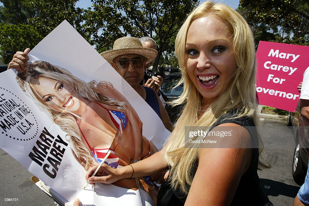 Porn star Mary Carey signs an autograph as she arrives at the Los Angeles County Registrar's office to turn in her papers to run for governor of California August 9, 2003 in Norwalk, California. Only a fraction of nearly 600 people who expressed interest in running have filed their papers to enter the race to unseat current Democratic Governor Gray Davis in the October 7 recall election. Carey's campaign platform calls for legalization of gay marriage, taxation of breast implants (she claims to be naturally large and calls implants a luxury), making lap dances a tax deductible business expense, and she promises to 'recruit fellow performers from the adult video industry as ambassadors of good will.'