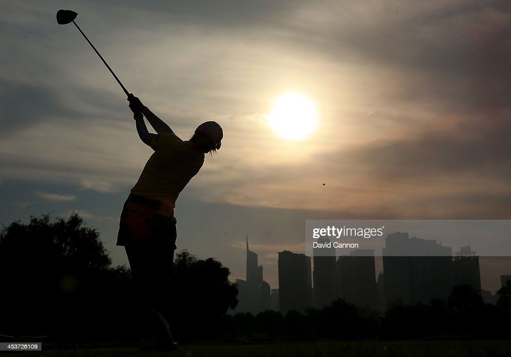 Pornanong Phatlum of Thailand plays her tee shot at the par 4, 14th hole during the second round of the 2013 Omega Dubai Ladies Masters on the Majilis Course at the Emirates Golf Club on December 5, 2013 in Dubai, United Arab Emirates.