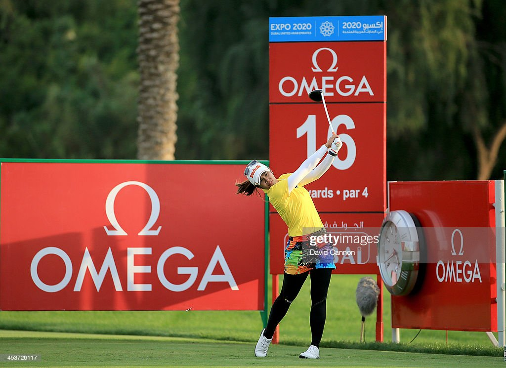 Pornanong Phatlum of Thailand plays her tee shot at the par 4, 16th hole during the second round of the 2013 Omega Dubai Ladies Masters on the Majilis Course at the Emirates Golf Club on December 5, 2013 in Dubai, United Arab Emirates.
