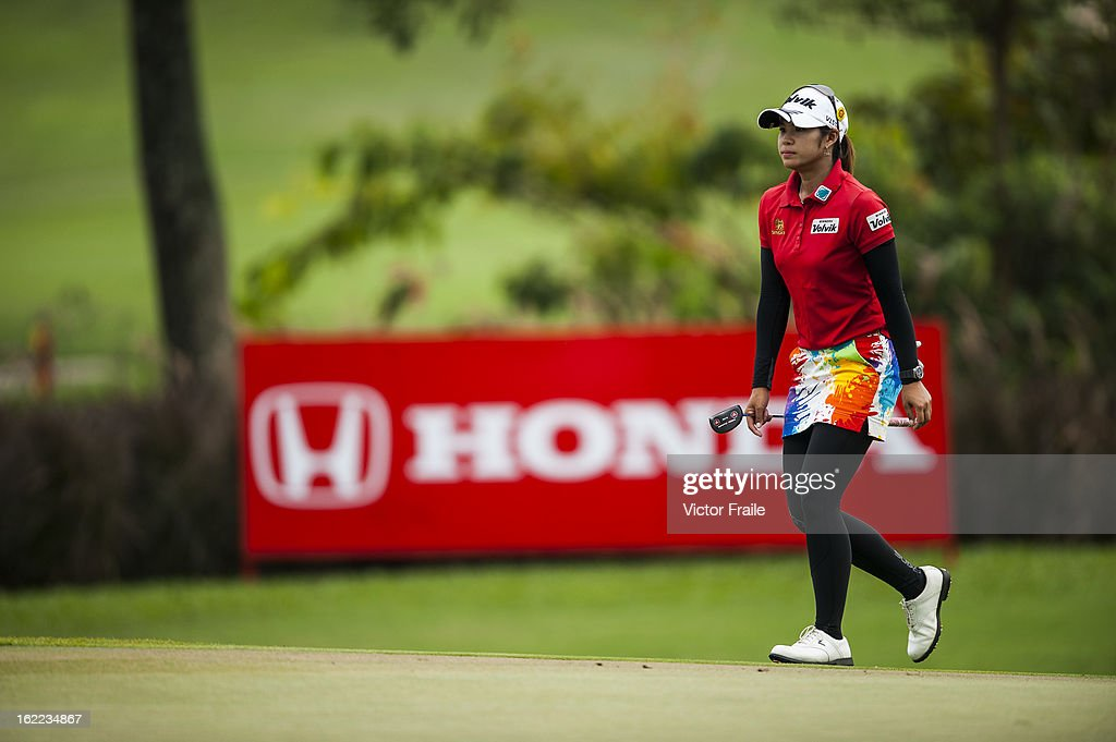 Pornanong Phatlum of Thailand walks on the 15th hole during day one of the 2013 Honda LPGA Thailand at Siam Country Club on February 21, 2013 in Chon Buri, Thailand.