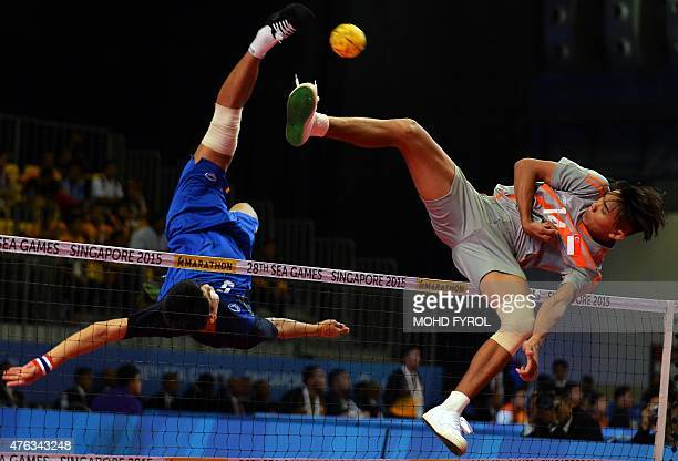 Pornchai Kaokaew of Thailand jumps for the ball against Muhammad A'fif of Singapore during the men's team sepaktakraw preliminary round match at the...