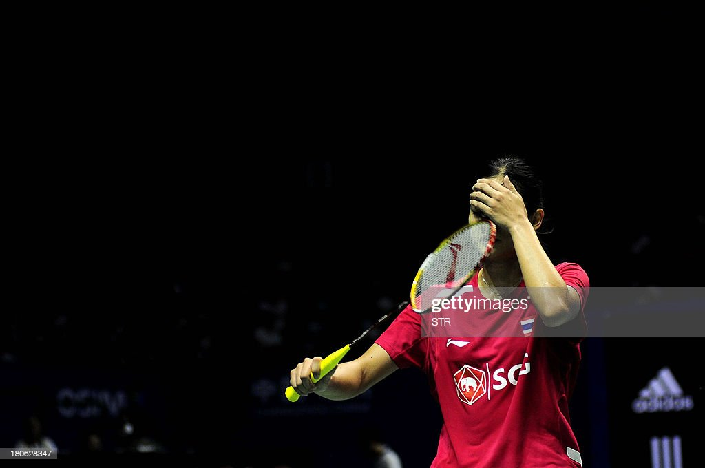 Porntip Buranaprasertsuk of Thailand reacts to bad return to Liu Xin of China during the women's singles final match of the 2013 China Masters in Changzhou, east China's Jiangsu province on September 15, 2013. Liu won 21-4, 13-21, 21-12. CHINA