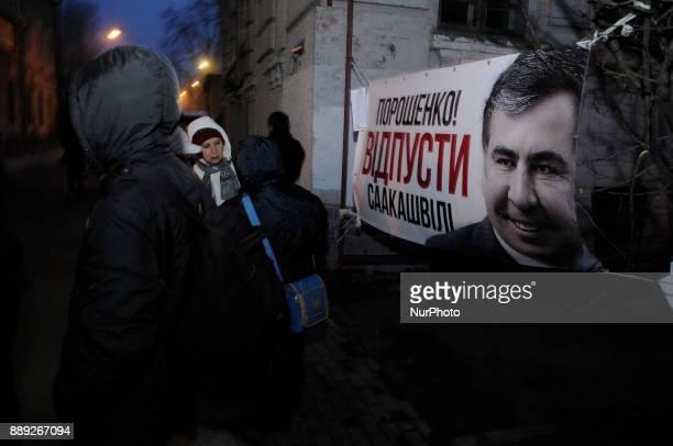 Poroshenko ousted Saakashvili is seen on a banner near the detention center where Saakashvili has been held since Friday in Kiev Ukraine on December...