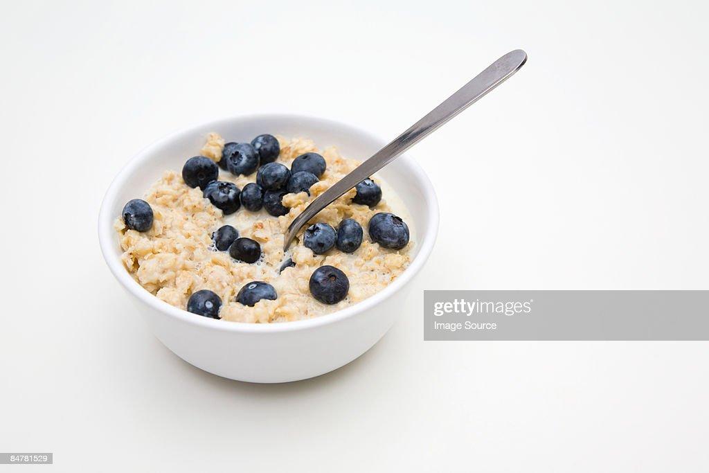 Porridge and blueberries : Stock Photo