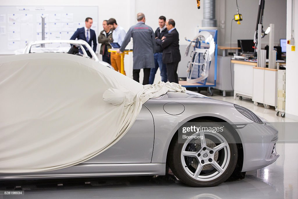 A Porsche 718 Cayman luxury automobile sits under a sheet during a quality control workshop at the automaker's headquarters in Stuttgart, Germany, on Wednesday, May 4, 2016. After the upscale Audi brand, Porsche is the second-largest earnings contributor at Volkswagen and generates the group's highest margins. Photographer: Krisztian Bocsi/Bloomberg via Getty Images