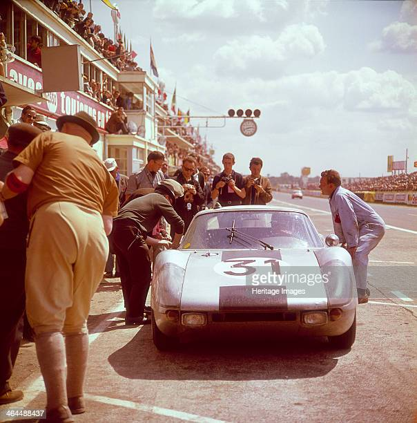 A Porsche 904/4 GTS in the pits Le Mans 1964 Driven either by Gerhard Koch or Heinz Schiller Photographers stand behind the car waiting to take a...