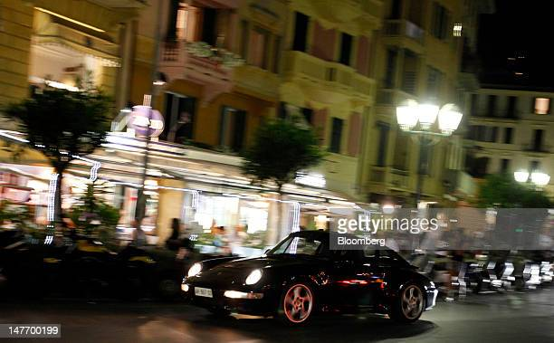 A Porsche 911 automobile is driven through Santa Margherita Ligure Italy on Saturday June 30 2012 Italy's economy will shrink 24 percent this year...