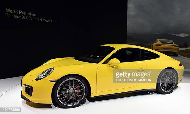 A Porsche 911 Carrera 4S is displayed after its premiere at the Tokyo Motor Show in Tokyo on October 29 2015 The biennial motor show's 44th edition...
