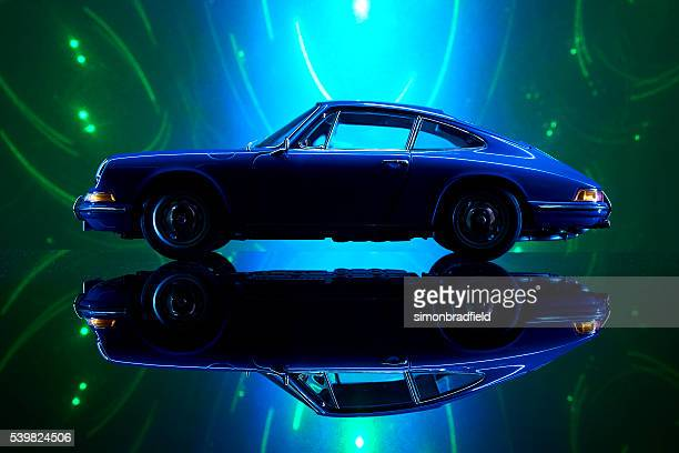 Porsche 911 Modell und wirbelnde hellem Hintergrund