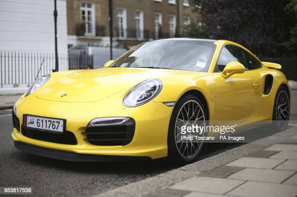 A Porsche 911 turbo S from Qatar parked in Knightsbridge in London as August sees hundreds of superrich Middle Easterners flying in from countries...