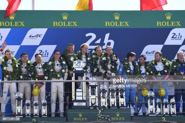 Porsche 919 Hybrid N°2 team German's driver Timo Bernhard New Zeland's driver Earl Bamber New Zeland's driver Brendon Hartley flanked by Jackie Chan...