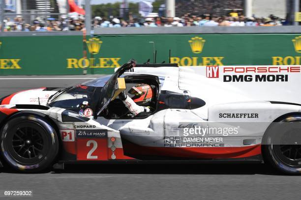Porsche 919 Hybrid N°2 team Germany's driver Timo Bernhard celebrates after winning the Le Mans 24 hours endurance race on June 18 2017 in Le Mans...