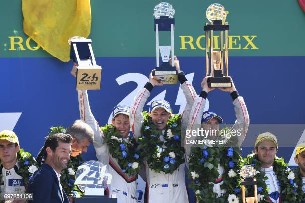 Porsche 919 Hybrid N°2 team Germany's driver Timo Bernhard New Zealand's driver Earl Bamber and New Zealand's driver Brendon Hartley celebrate on the...