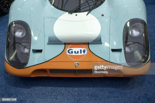 Porsche AG 917k race vehicle formerly driven by actor Steve McQueen in the movie 'Le Mans' sits on display at the Gooding and Company auction during...