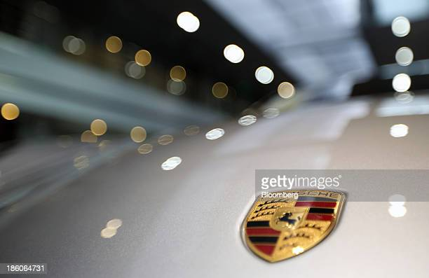 A Porsche AG badge is displayed on a Panamera Turbo sedan displayed at the Porsche Centre Shanghai Minhang showroom in Shanghai China on Friday Oct...