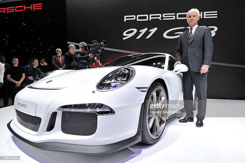 Porsche AG CEO Matthias Mueller looks on during the 83rd Geneva Motor Show on March 5, 2013 in Geneva, Switzerland. Held annually the Geneva Motor Show is one of the world's five most important auto shows with this year's event due to unveil more than 130 new products.