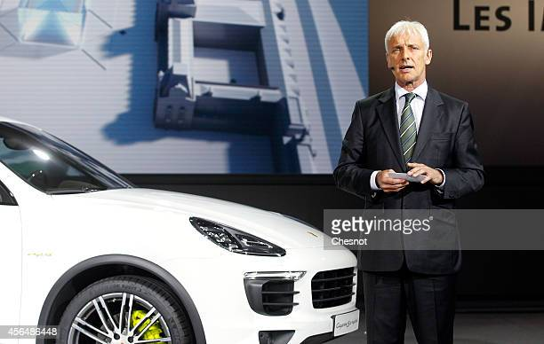 Porsche AG President and CEO Matthias Muller presents the new Porsche Cayenne S ehybrid during the Volkswagen Group Night show prior to the opening...