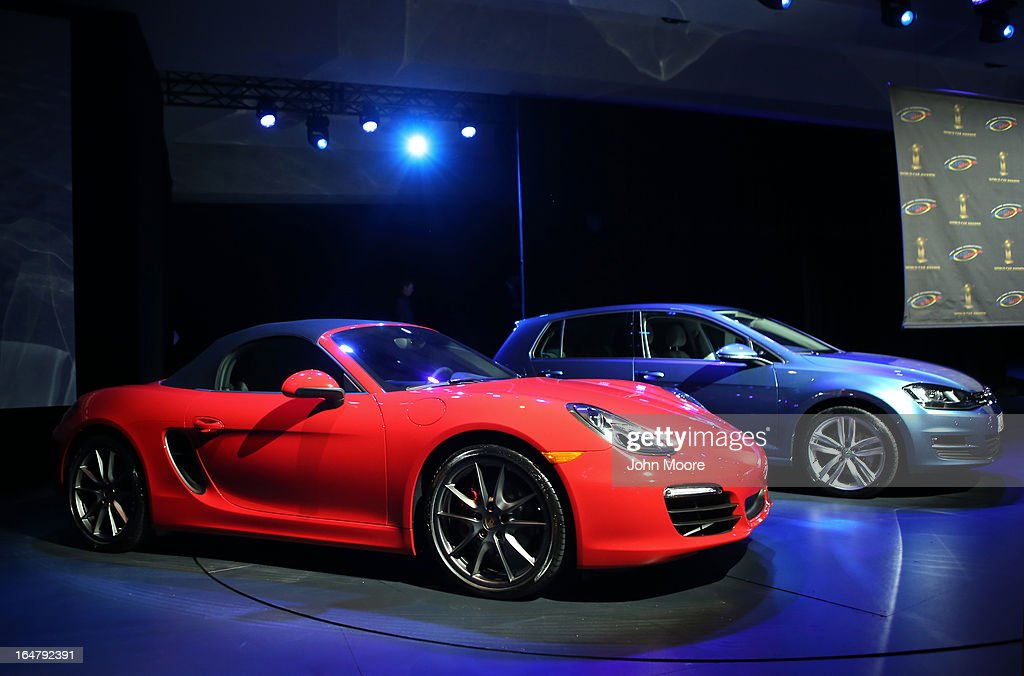A Porsche Boxster/Cayman (L), is displayed before being named the 2013 World Performance Car of the Year at the New York Auto Show on March 28, 2013 in New York City. It was the second consecutive year that Porsche has won the prestigious title and the third overall.