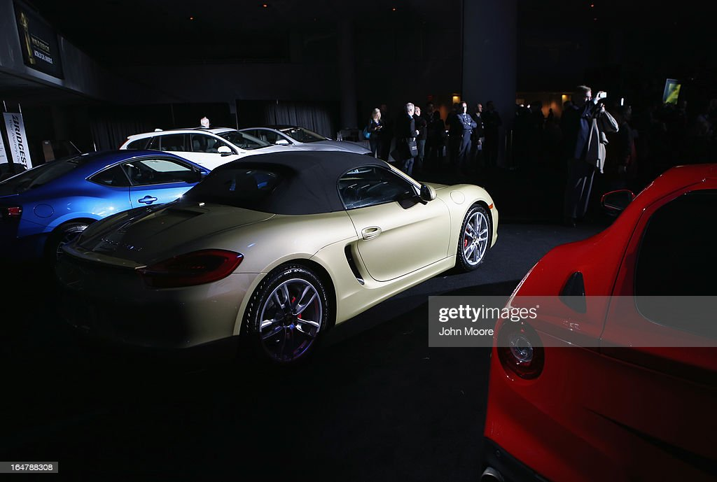 A Porsche Boxster/Cayman (C) is displayed with other cars after being named the 2013 World Performance Car of the Year at the New York Auto Show on March 28, 2013 in New York City. It was the second consecutive year that Porsche has won the prestigious title and the third time overall.
