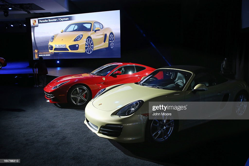 A Porsche Boxster/Cayman (R) sits on display after being named the 2013 World Performance Car of the Year at the New York Auto Show on March 28, 2013 in New York City. It was the second consecutive year that Porsche has won the prestigious title and the third overall.