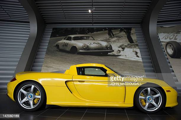 A Porsche Carrera GT model is on display in the customer centre of the Porsche plant in Leipzig eastern Germany March 28 2012 Porsche's Leipzig...