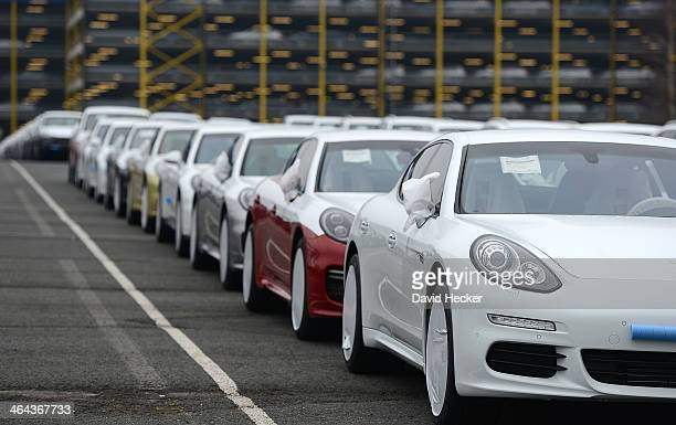 Porsche cars destined for export overseas stand parked and waiting to be loaded onto ships on January 22 2014 in Bremerhaven Germany Bremerhaven is...