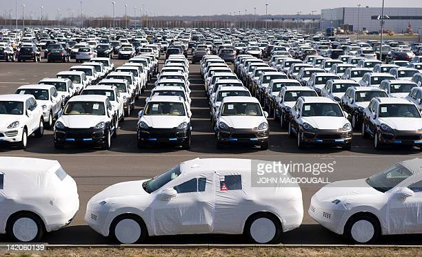Porsche Cayenne and Panamera models are parked in a lot at the Porsche plant in Leipzig eastern Germany March 28 waiting to be dispatched to clients...