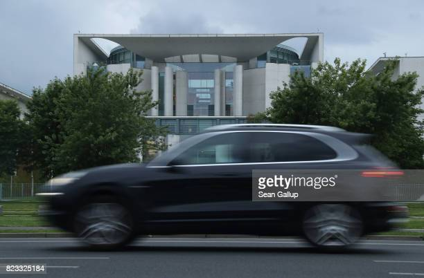 Porsche Cayenne drives past the Chancellery on July 24 2017 in Berlin Germany Three of Germany's biggest carmakers including Daimler which owns the...