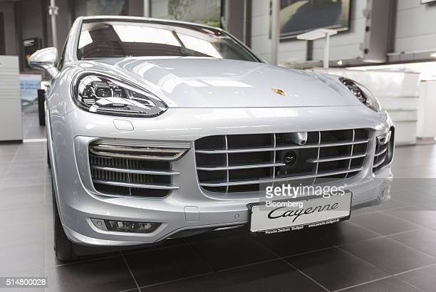 A Porsche Cayenne GTS luxury automobile sits on display inside a Porsche AG showroom in Stuttgart Germany on Friday March 11 2016 Porsche the maker...