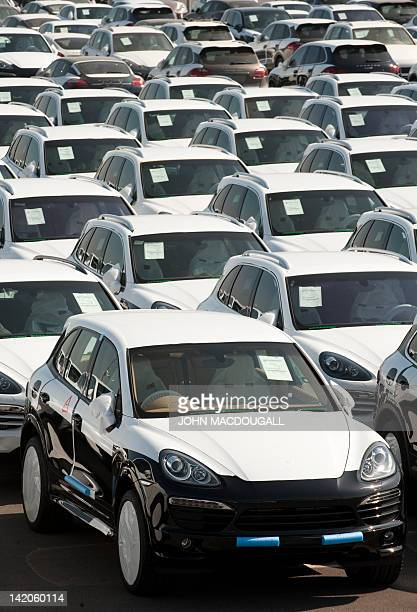 Porsche Cayenne models are parked in a lot at the Porsche plant in Leipzig eastern Germany March 28 waiting to be dispatched to clients around the...