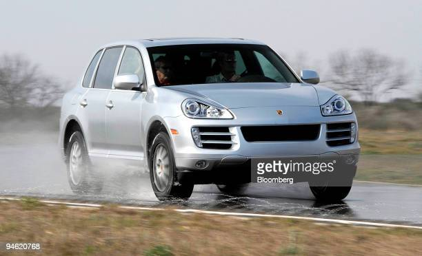 Porsche Cayenne Turbo winds its way through the wet road course at Continental Tires Uvalde Proving Grounds in Uvalde Texas Wednesday Feb 28 2007