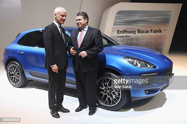Porsche CEO Matthias Mueller and German Vice Chancellor and Economy and Energy Minister Sigmar Gabriel pose next to a Porsche Macan SUV at the...