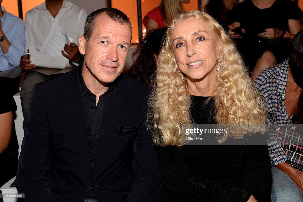 Porsche Design CEO Juergen Gessler and editorinchief of Vogue Italia Franca Sozzani attend the Porsche Design Spring/Summer 2015 fashion show during...