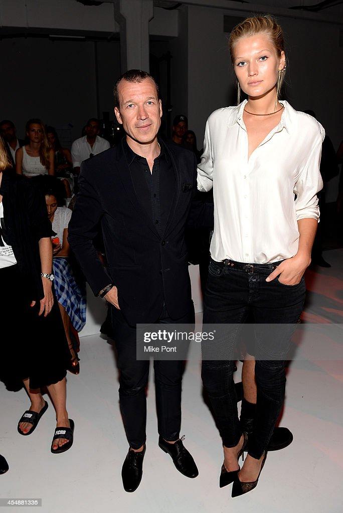 Porsche Design CEO Juergen Gessler and model Toni Garrn attend the Porsche Design Spring/Summer 2015 fashion show during MercedesBenz Fashion Week...