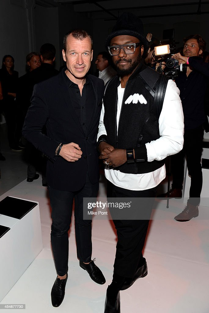 Porsche Design CEO Juergen Gessler and rapper Will i Am at the Porsche Design Spring/Summer 2015 fashion show during MercedesBenz Fashion Week Spring...