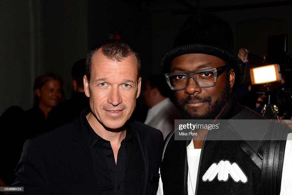 Porsche Design CEO Juergen Gessler and rapper Will i Am attend the Porsche Design Spring/Summer 2015 fashion show during MercedesBenz Fashion Week...