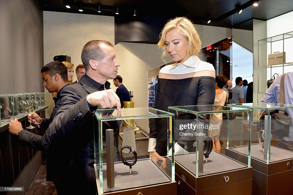 Porsche Design CEO Juergen Gessler and tennis player <a gi-track='captionPersonalityLinkClicked' href=/galleries/search?phrase=Maria+Sharapova&family=editorial&specificpeople=157600 ng-click='$event.stopPropagation()'>Maria Sharapova</a> attend the Porsche Design and Vogue re-opening event at Porsche Design Beverly Hills on July 11, 2013 in Beverly Hills, California.