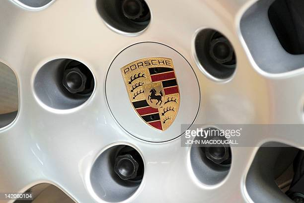 A Porsche emblem is seen on a hubcap of a Porsche Panamera model on the production line of the Porsche plant in Leipzig eastern Germany March 28 2012...