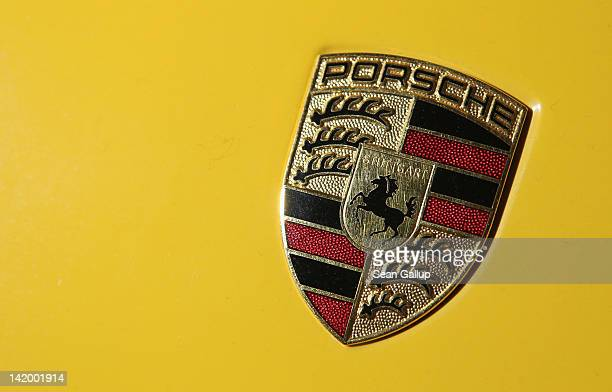 Porsche hood ornament decorates a Carrera GT in the historical museum at the Porsche factory on March 28 2012 in Leipzig Germany Porsche produced...