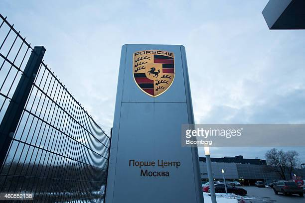 A Porsche logo sits on a sign at the entrance to a Porsche AG luxury automobile dealership in Moscow Russia on Monday Dec 15 2014 Russia's biggest...